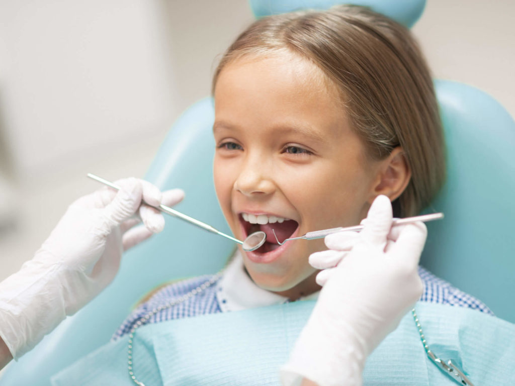 A young girl getting a dental checkup
