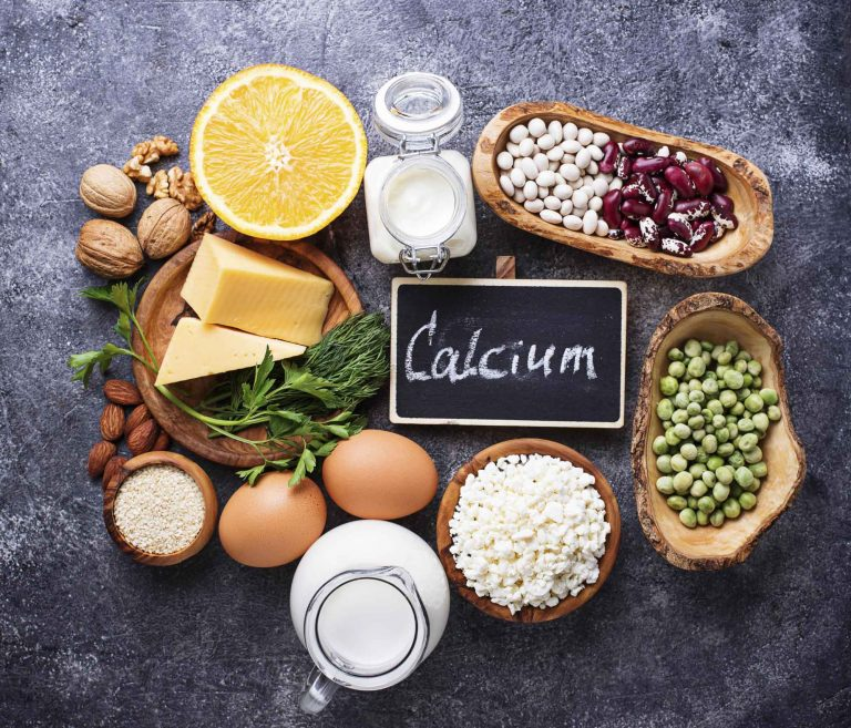 Illustration of foods high in calcium, including milk and cheese