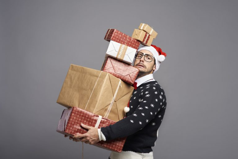 Portrait of a man carrying a lot of Christmas presents