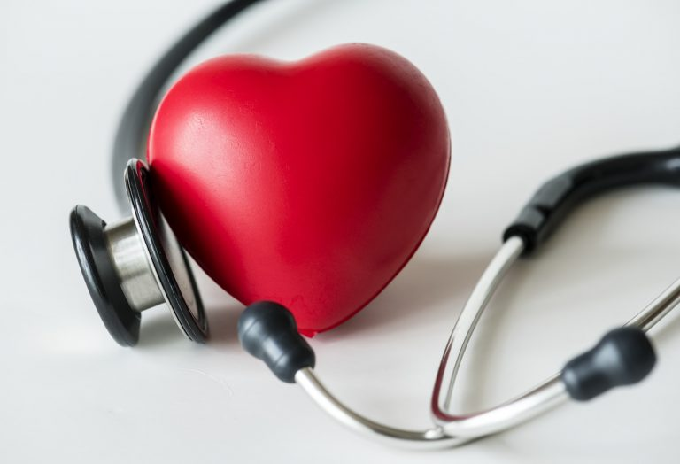 A heart shaped stress ball and a stethoscope