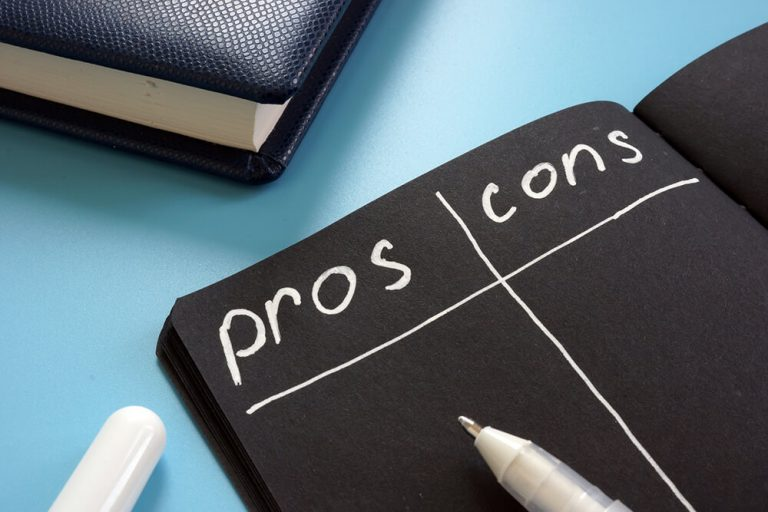 illustration of a pros and cons list on black paper with white text